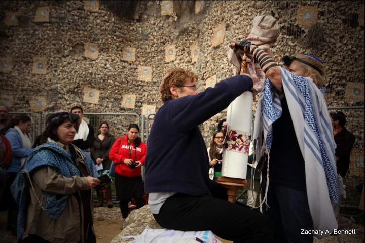 Women of the Wall Dress the Torah: After lifting the torah, Doris Schyman, 59, and Marian Richer, 68, dress the torah to conclude service. The two are visiting military volunteers from the United States