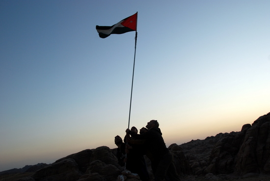 Raising Jordanian flag outside Petra